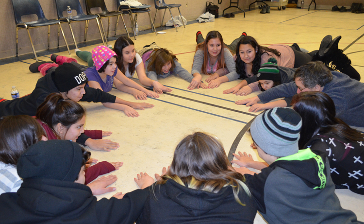 Warren Linds leads an activity called 'Hands on Floor' with youth participants at La Ronge Drama Workshop, January 2015. Photo courtesy of Acting Out!