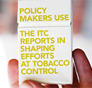 A hand holding a cigarette package with the message: Policy makers use the ITC reports in shaping efforts at tobacco control